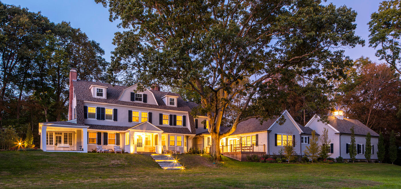 Home Addition featuring three car garage and deck in Milton, MA